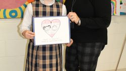 Third-grader designs logo for diocesan Day of Service