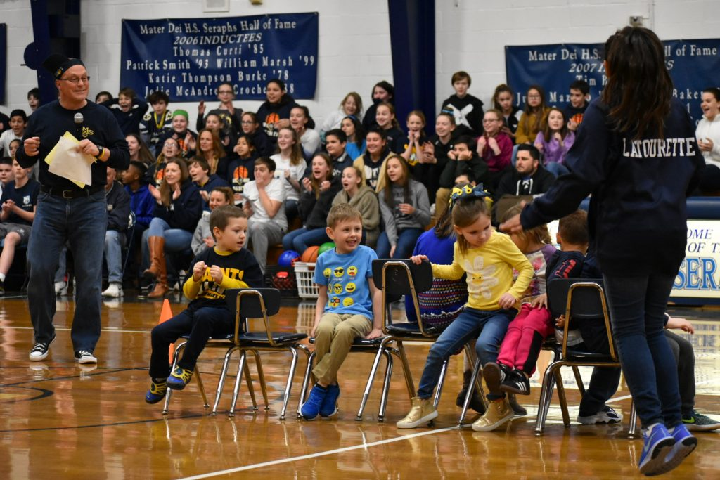 St. Mary School released a video highlight reel featuring aspects of its Catholic Schools Week 2019, like this game of musical chairs played by kindergartners as principal Craig Palmer, left, and other students cheer them on.  Courtesy photo