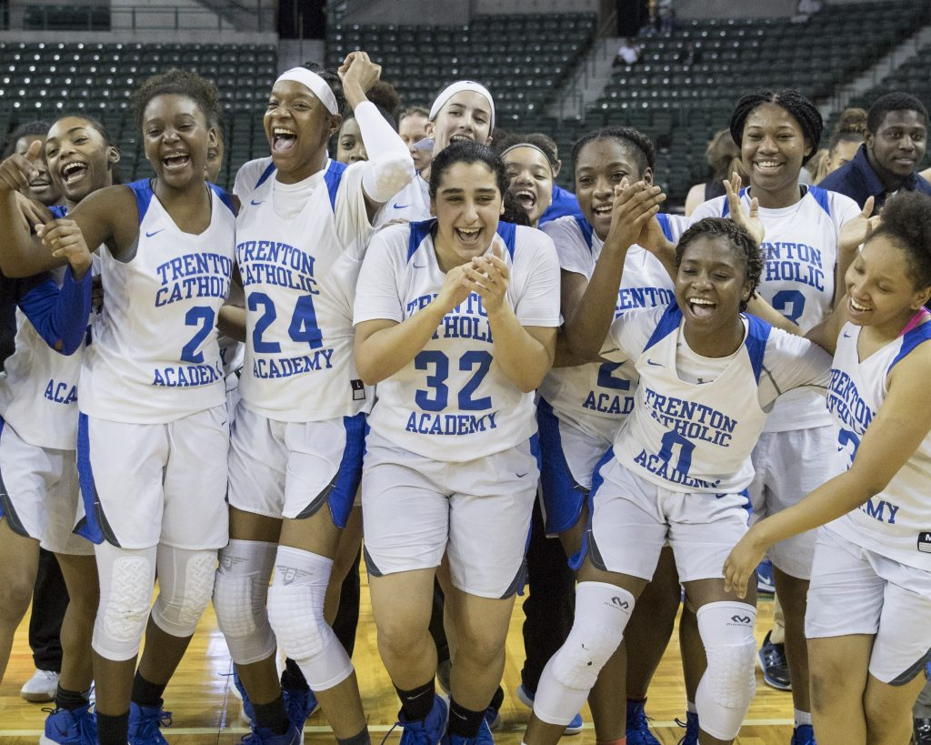 Trenton Catholic Academy girls basketball players celebrate winning the Mercer County Tournament championship game Feb. 21 at Trenton's Cure Insurance Arena. John Blaine photos