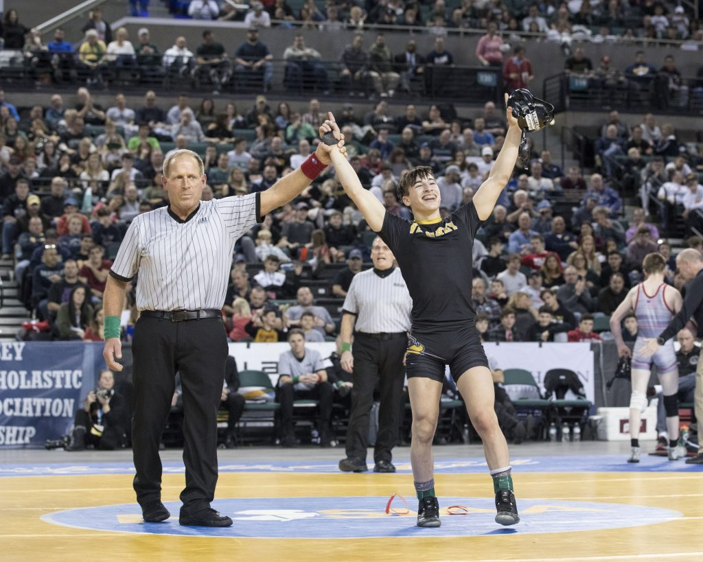 St. John Vianney sophomore Dean Peterson celebrates winning a NJSIAA State Championships title March 2 in Atlantic City. John Blaine photo