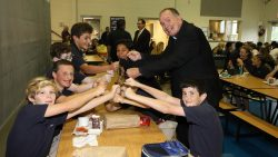 Holy Cross Academy celebrates new status with Bishop O'Connell